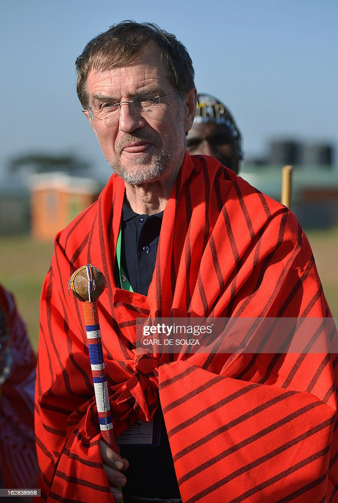 Head of the European Union Election Observation Mission (EU EOM) in Kenya Alojz Peterle is pictured in Maasai dress after it was presented to him as a present in Kiserian, outside Nairobi on February 28, 2013. Kenya is preparing for national elections on March 4, 2013 and the European Union has sent observers to report on the process and outcome. AFP PHOTO/Carl de Souza