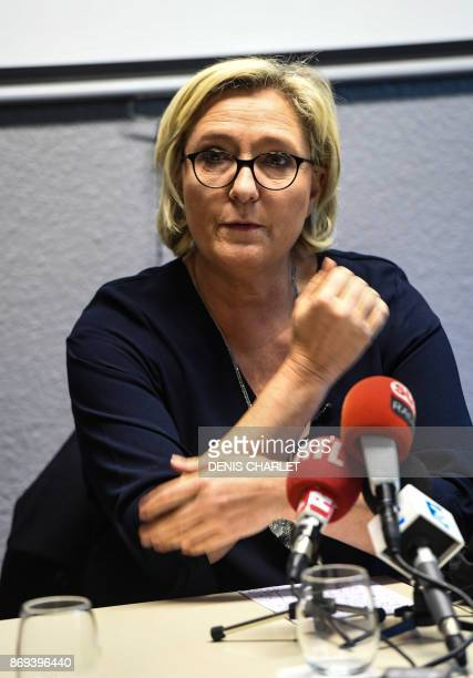 Head of the farright Front national party and French MP Marine Le Pen gives a press conference in Calais on November 2 after she visited the police...