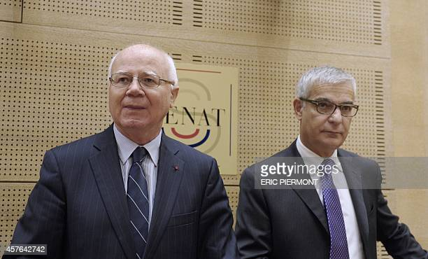 Head of the French Competition Authority Bruno Lasserre and Commission President Herve Maurey pose at the French Senate prior to the start of...