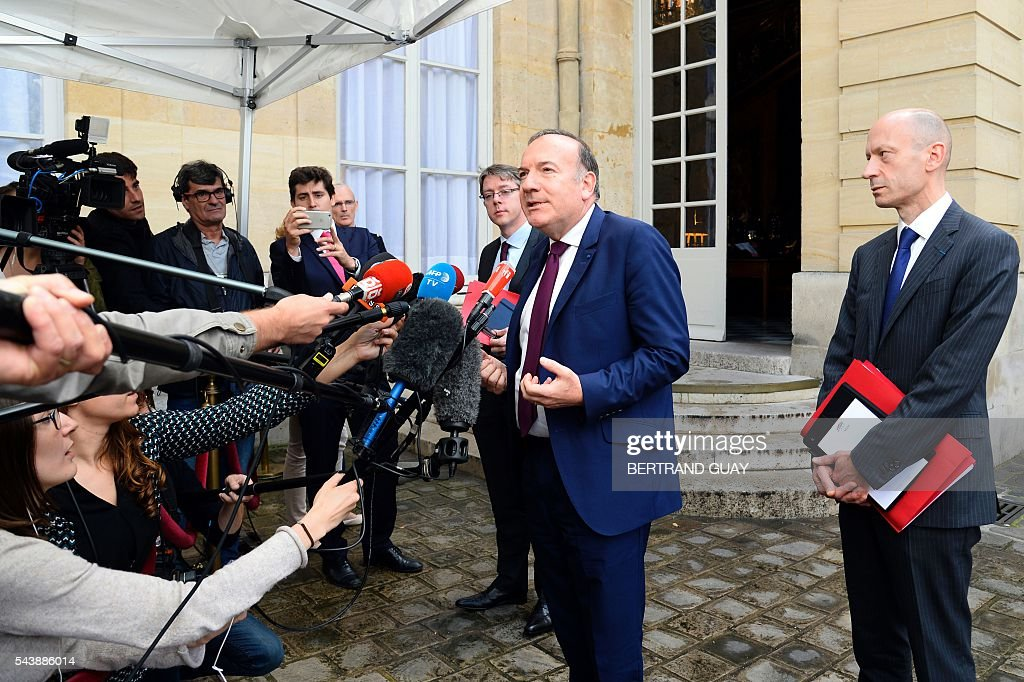 Head of the French Employers Federation Medef, Pierre Gattaz (C) addresses the media within a meeting with the French Prime Minister and the French Labour Minister on June 30, 2016 at the Hotel Matignon in Paris. French President Francois Hollande said last week that his Socialist government would 'go all the way' to enact the labour reforms, which are seen by critics as too pro-business and a threat to cherished workers' rights. / AFP / BERTRAND
