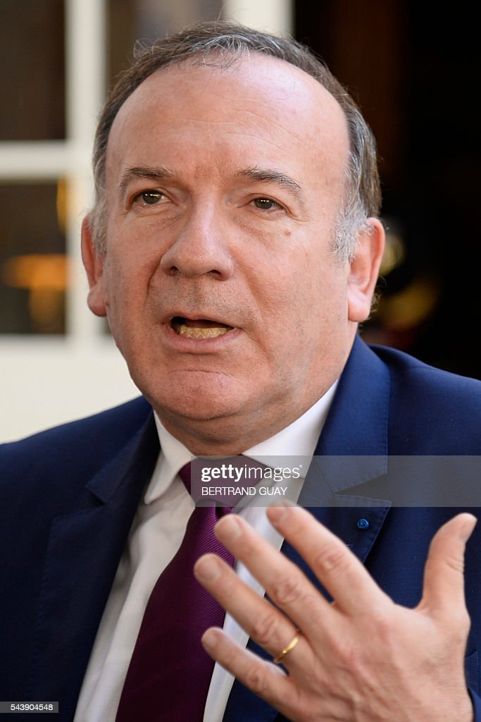 Head of the French Employers Federation Medef, Pierre Gattaz addresses the media following a meeting with the French Prime Minister and the French Labour Minister on June 30, 2016 at the Hotel Matignon in Paris. French President Francois Hollande said last week that his Socialist government would 'go all the way' to enact the labour reforms, which are seen by critics as too pro-business and a threat to cherished workers' rights. / AFP / BERTRAND