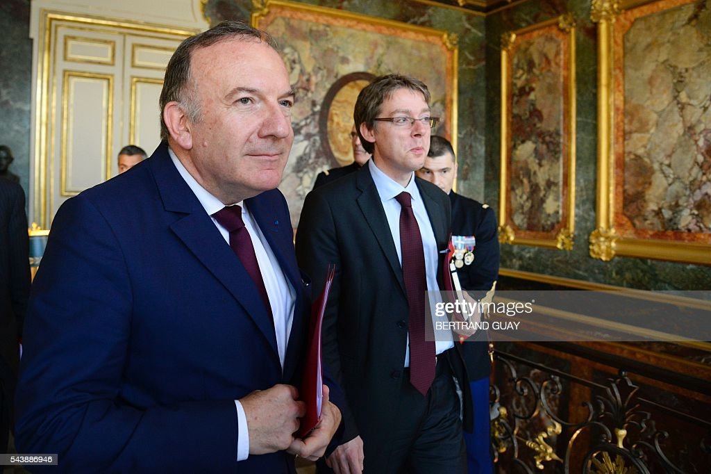 Head of the French Employers Federation Medef, Pierre Gattaz (L) and Gattaz' head of cabinet, Olivier Gainon (R) leave following a meeting with the French Prime Minister and the French Labour Minister on June 30, 2016 at the Hotel Matignon in Paris. French President Francois Hollande said last week that his Socialist government would 'go all the way' to enact the labour reforms, which are seen by critics as too pro-business and a threat to cherished workers' rights. / AFP / BERTRAND