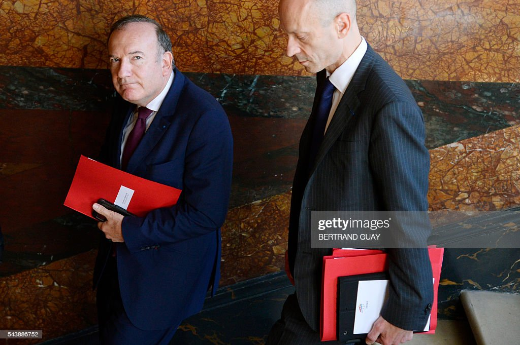 Head of the French Employers Federation Medef, Pierre Gattaz and Director General of Medef, Michel Guilbaud leave following a meeting with the French Prime Minister and the French Labour Minister on June 30, 2016 at the Hotel Matignon in Paris. French President Francois Hollande said last week that his Socialist government would 'go all the way' to enact the labour reforms, which are seen by critics as too pro-business and a threat to cherished workers' rights. / AFP / BERTRAND