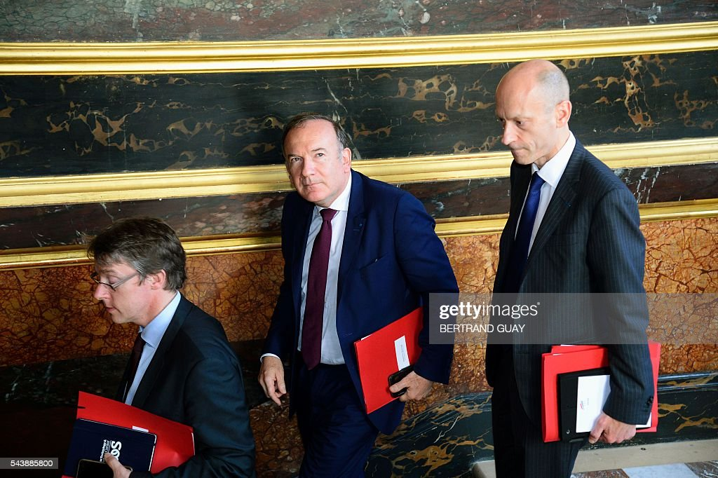 Head of the French Employers Federation Medef, Pierre Gattaz (C) and his aides leave following a meeting with the French Prime Minister and the French Labour Minister on June 30, 2016 at the Hotel Matignon in Paris. French President Francois Hollande said last week that his Socialist government would 'go all the way' to enact the labour reforms, which are seen by critics as too pro-business and a threat to cherished workers' rights. / AFP / BERTRAND
