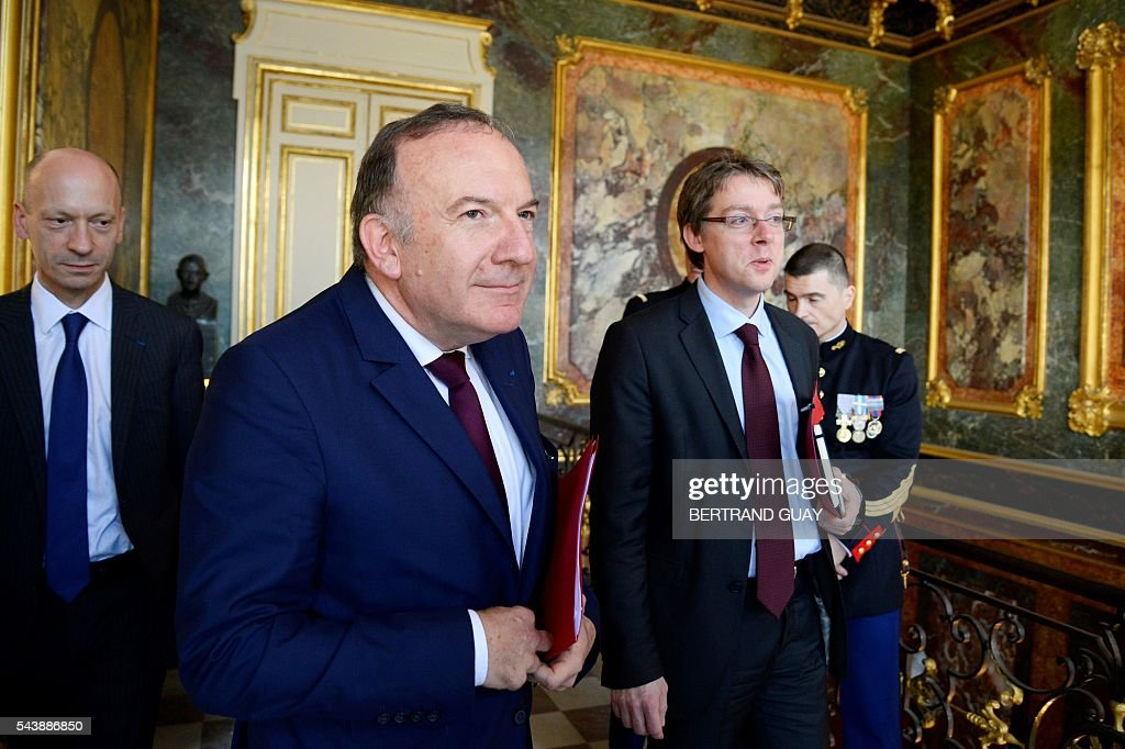 Head of the French Employers Federation Medef, Pierre Gattaz (C), Director General of Medef, Michel Guilbaud (L) and Gattaz' head of cabinet, Olivier Gainon (R) leave following a meeting with the French Prime Minister and the French Labour Minister on June 30, 2016 at the Hotel Matignon in Paris. French President Francois Hollande said last week that his Socialist government would 'go all the way' to enact the labour reforms, which are seen by critics as too pro-business and a threat to cherished workers' rights. / AFP / BERTRAND