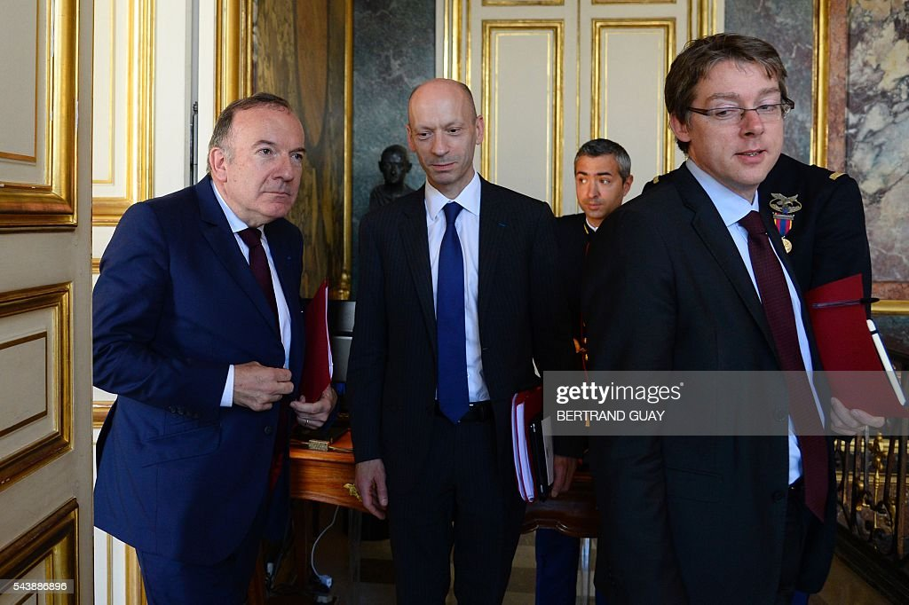 Head of the French Employers Federation Medef, Pierre Gattaz (L), Director General of Medef, Michel Guilbaud (C) and Gattaz' head of cabinet, Olivier Gainon (R) leave following a meeting with the French Prime Minister and the French Labour Minister on June 30, 2016 at the Hotel Matignon in Paris. French President Francois Hollande said last week that his Socialist government would 'go all the way' to enact the labour reforms, which are seen by critics as too pro-business and a threat to cherished workers' rights. / AFP / BERTRAND