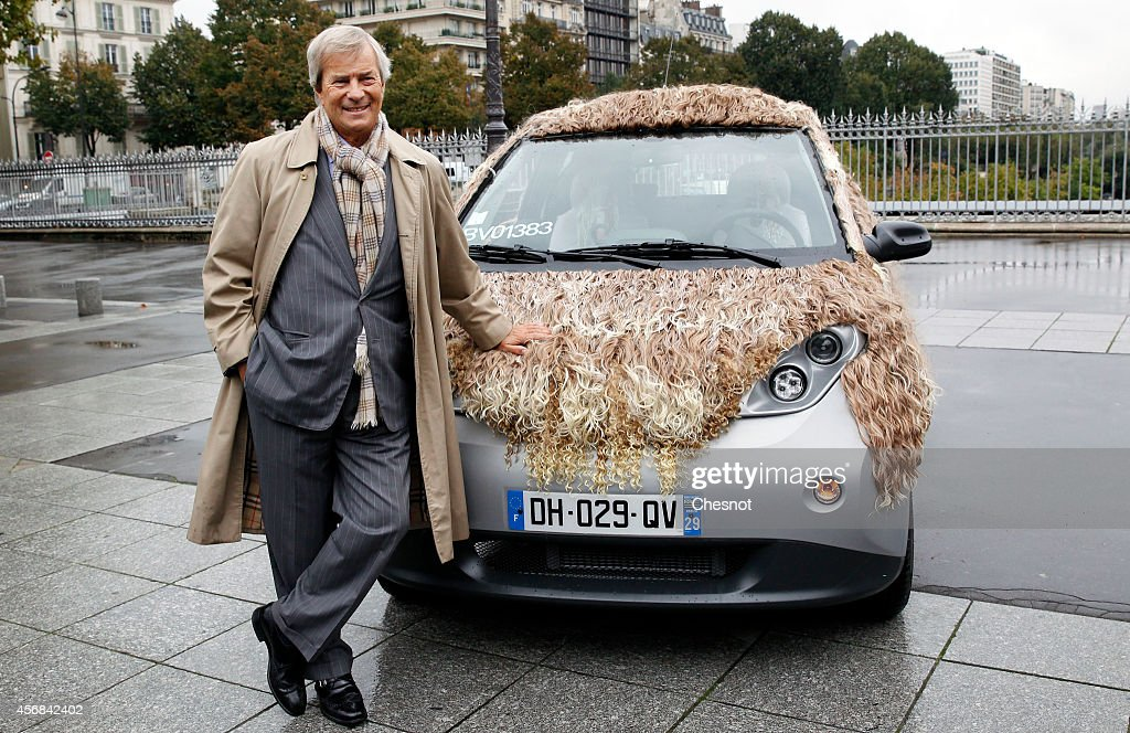 Head of the French industrial group Bollore, Vincent Bollore, poses presenting a car named Cavalcade, one of the nine new customized Autolib cars on October 8, 2014 in Paris, France. Autolib is a French electric car pick-up service.
