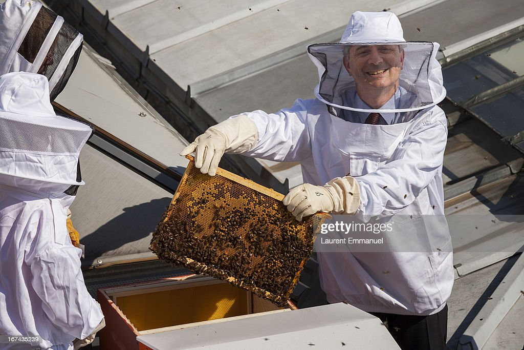 Head of the French national assembly Claude Bartolone holds a beehive frame at Palais Bourbon, on April 25, 2013 in Paris, France. Some 60,000 bees in the three beehives are being installed on the roof of the Assemblee Nationale building.