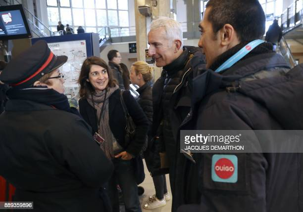 head of the French national stateowned railway company SNCF Guillaume Pepy speaks with SNCF workers as a lowcost TGV highspeed train 'Ouigo' started...