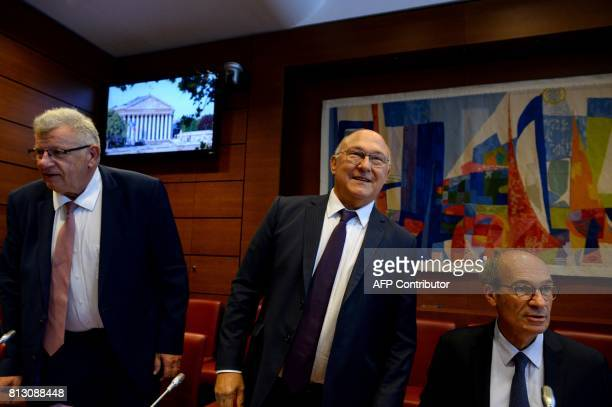 Head of the French parliament finance commission Eric Woerth arrives with former French Economy Minister Michel Sapin and former Junior Minister for...