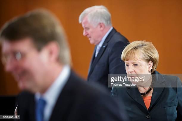 Head of the German Chancellery Ronald Pofalla Chairman of the Bavarian Christian Democrats Horst Seehofer and German Chancellor Angela Merkel arrives...