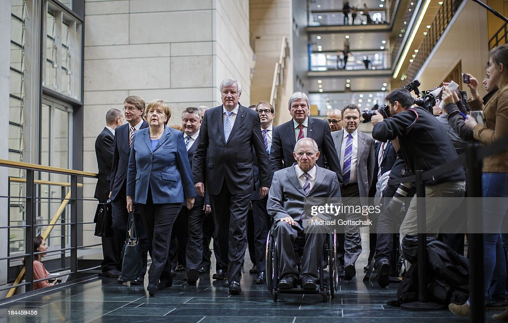 Head of the German Chancellery <a gi-track='captionPersonalityLinkClicked' href=/galleries/search?phrase=Ronald+Pofalla&family=editorial&specificpeople=657117 ng-click='$event.stopPropagation()'>Ronald Pofalla</a>, German Chancellor Angela Merkel, Bavarian Premier and Chairman of the Christian Social Union of Bavaria (CSU), <a gi-track='captionPersonalityLinkClicked' href=/galleries/search?phrase=Horst+Seehofer&family=editorial&specificpeople=4273631 ng-click='$event.stopPropagation()'>Horst Seehofer</a>, Minister-president of Hesse <a gi-track='captionPersonalityLinkClicked' href=/galleries/search?phrase=Volker+Bouffier&family=editorial&specificpeople=2371294 ng-click='$event.stopPropagation()'>Volker Bouffier</a> (CDU), German Finance Minister Wolfgang Schaeuble, and German Interior Minister Hans-Peter Friedrich arrive for a meeting at the German Bundestag on October 14, 2013 in Berlin, Germany. The German Chancellor met with the opposition Social Democratic Party for a second round of talks over a possible coalition.