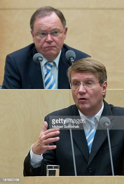 Head of the German Chancellery Ronald Pofalla speaks in front of Stephan Weil Prime Minister of German State LowerSaxony and President of the...