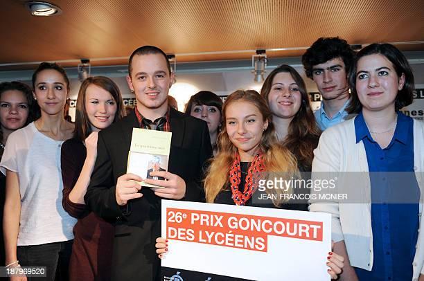Head of the Goncourt des Lyceens literary prize jury Etienne Berteaux presents the winning novel ' Le quatrième mur' written by French journalist and...
