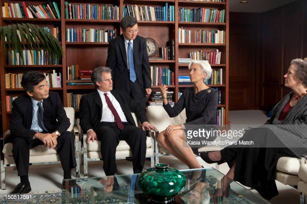 Head of the IMF Christine Lagarde is photographed at her office with Naoyuki Shinohara David Lipton Zu Min and Tessa Wan der Willgen for Paris Match...