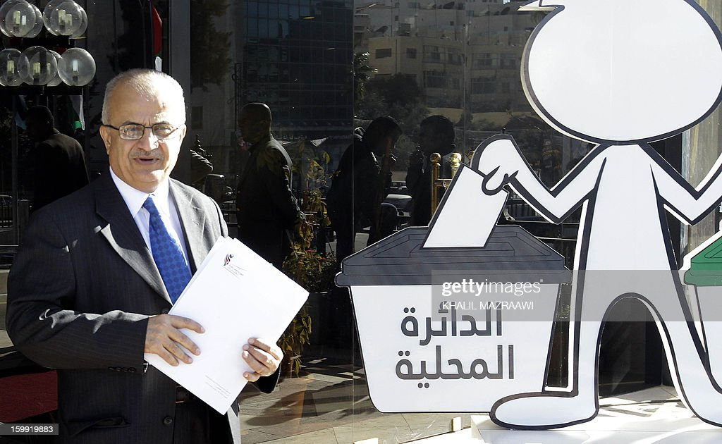 Head of the Independent Commission for Elections Abdul Ellah Al-Khatib looks over following a press conference in Amman on January 23, 2013. Jordanians are voting in a parliamentary poll snubbed by Islamists who have staged strident pro-reform protests and who have already slammed what is expected to be an opposition-free body as illegitimate.