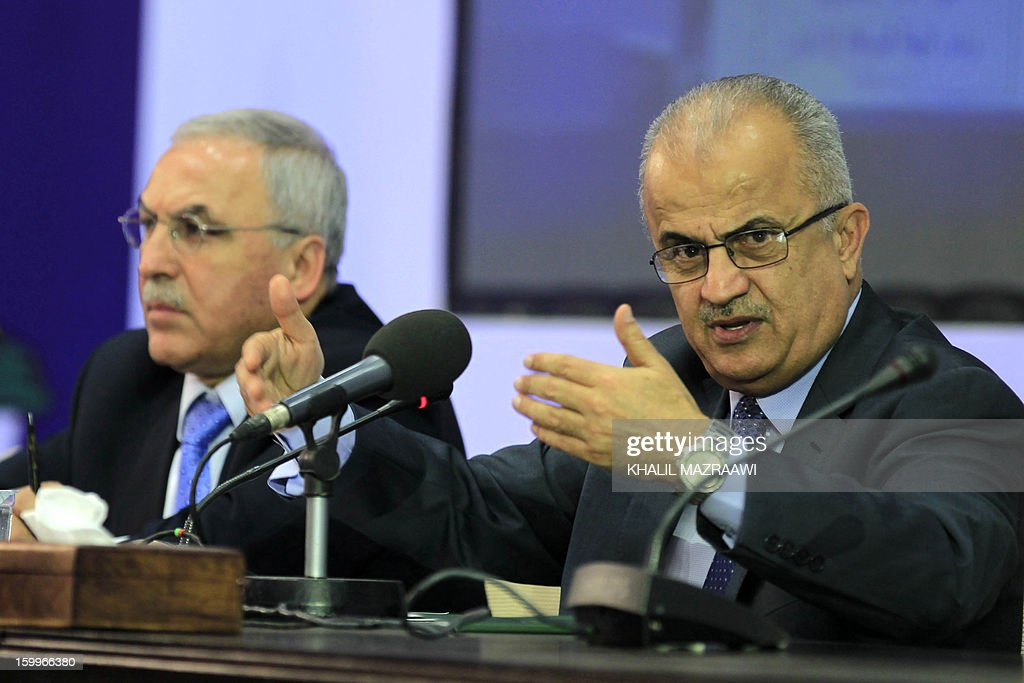 Head of the Independent Commission for Elections Abdul Ellah Al-Khatib (R) speaks as Hussein Bani Hani the Independent Commission spokesman (L) listens on during a press conference in Amman to announce the results of the parliamentary elections on January 24, 2013. Tribal leaders, pro-regime loyalists and independent businessmen looked set to sweep Jordan's parliamentary election that was shunned by Islamists, according to initial results released earlier in the day.