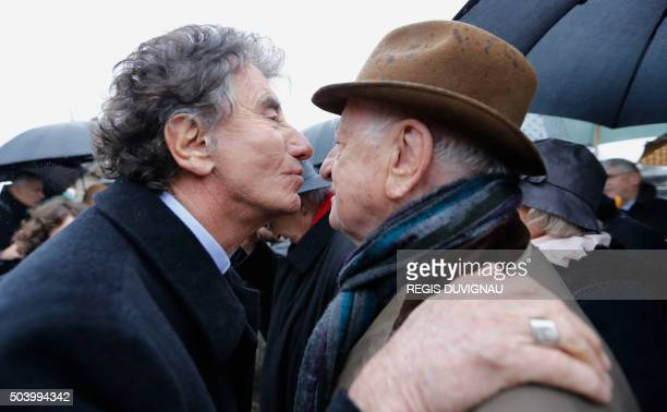 Head of the Institut du Monde Arabe Jack Lang greets French businessman Pierre Berge during a ceremony marking the 20th anniversary of the death of...