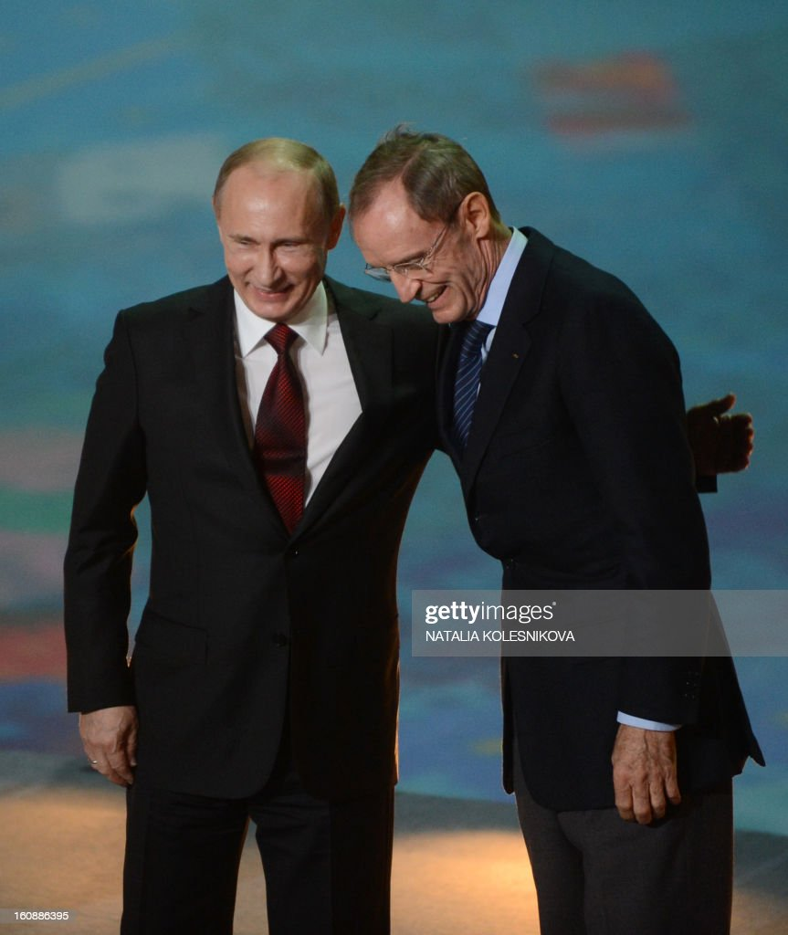 Head of the International Olympic Committee's coordination commission Jean-Claude Killy (R) and Russia's President Vladimir Putin take part in a ceremony celebrating the one year countdown to the Sochi 2014 Winter Olympics opening at the Bolshoi Ice Dome rink in the Black Sea city of Sochi, on February 7, 2013. Putin vowed today Russia would justify expectations when it hosts the Winter Olympic Games in Sochi in one year, after ruthlessly firing an official blamed for delays in building infrastructure. AFP PHOTO / NATALIA KOLESNIKOVA