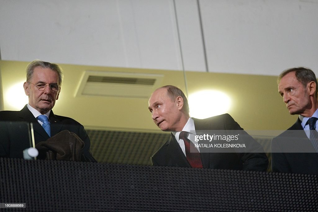 Head of the International Olympic Committee's coordination commission Jean-Claude Killy, Russia's President Vladimir Putin and IOC President Jacques Rogge attend a ceremony celebrating the one year countdown to the Sochi 2014 Winter Olympics opening at the Bolshoi Ice Dome rink in the Black Sea city of Sochi, on February 7, 2013. Putin vowed today Russia would justify expectations when it hosts the Winter Olympic Games in Sochi in one year, after ruthlessly firing an official blamed for delays in building infrastructure. AFP PHOTO / NATALIA KOLESNIKOVA