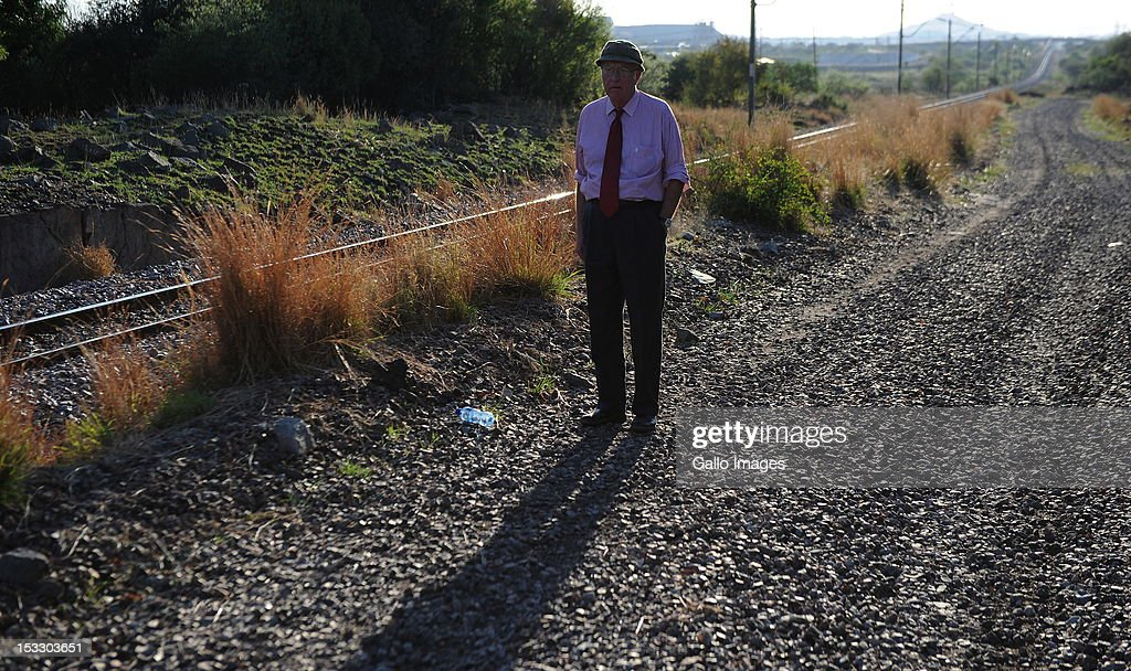 Head of the Marikana Commission of Inquiry Ian Farlam examines the area on October 3, 2012 in Rustenberg, South Africa. The Commission which is investigating what led to the deaths of 46 people during a violent wage strike by Lonmin mine workers has been delayed to allow lawyers to speak to the families of the victims.