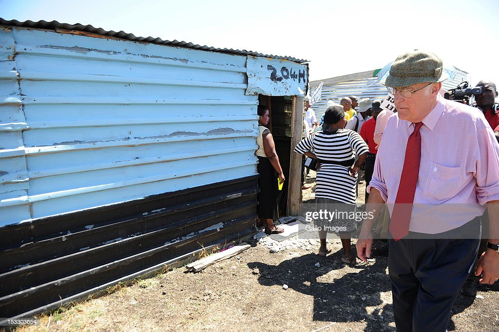 Head of the Marikana Commission of Inquiry Ian Farlam visits the area on October 3, 2012 in Rustenberg, South Africa. The Commission which is investigating what led to the deaths of 46 people during a violent wage strike by Lonmin mine workers has been delayed to allow lawyers to speak to the families of the victims.
