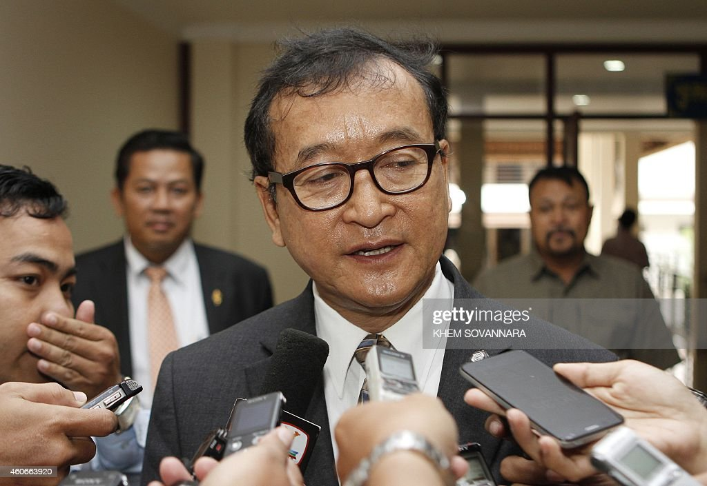 Head of the opposition Cambodia National Rescue Party Sam Rainsy addresses reporters at the National Assembly building in Phnom Penh on December 19...