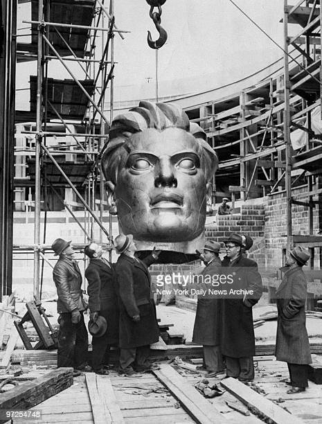 Head of the 'Spirit of the Soviet Worker' being hoisted to top of 79foot statue at the Russian exhibit at World's Fair