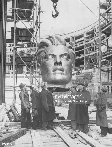Head of the 'Spirit of the Soviet Worker' is hoisted to top of a 79foothigh statue at the Soviet Union's exhibit at World's Fair