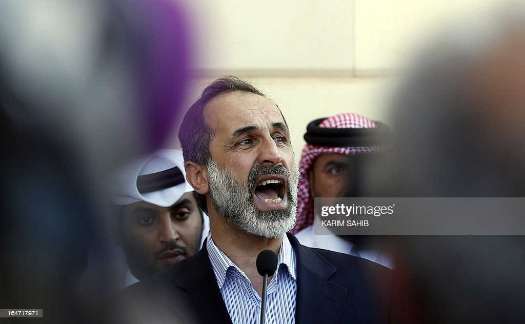 Head of the Syrian opposition delegation, Ahmed Moaz al-Khatib, gives a speech during the inauguration of the first embassy of the Syrian interim government to open in Qatar, in the capital Doha on March 27, 2013.