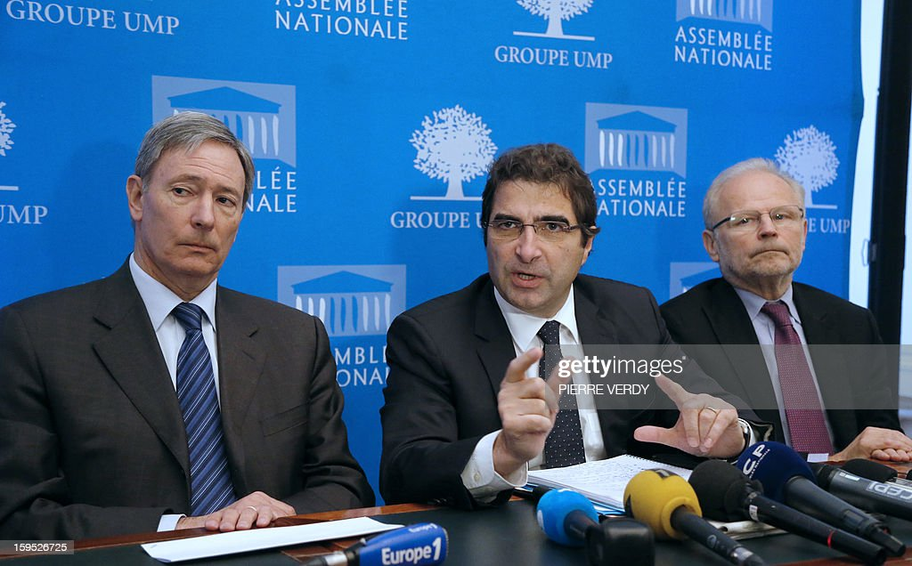 Head of the UMP group at the national assembly Christian Jacob (C) gives a press conference next to UMP deputies Christian Kert (R) and Bernard Deflesselles give a press conference, on January 15, 2013 at the national assembly in Paris.