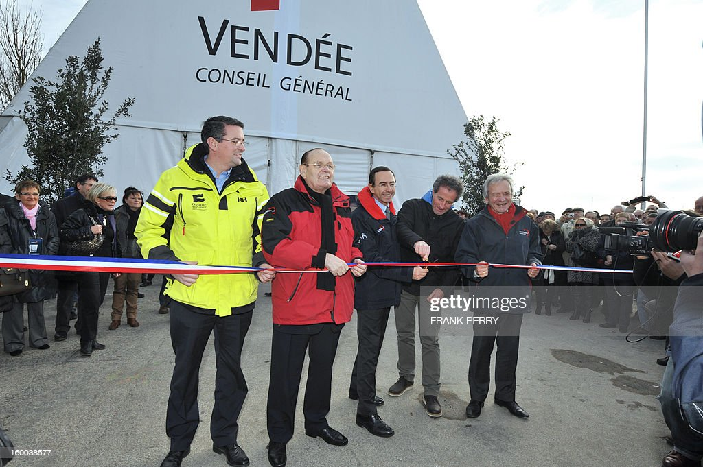 Head of the Vendee general council Bruno Retailleau (C) French skipper Michel Desjoyeaux (2ndR) Sables d' Olonne mayor Louis Guedon (L) inaugurate the Vendee Globe village on January 25, 2013 in Les Sables-d'Olonne. The Vendee Globe racers are approaching the French port of Les Sables d'Olonne, the finish line of the toughest, solo, round the world sailing race. The first finishers should be arriving in the next 24 hours. AFP PHOTO FRANK PERRY