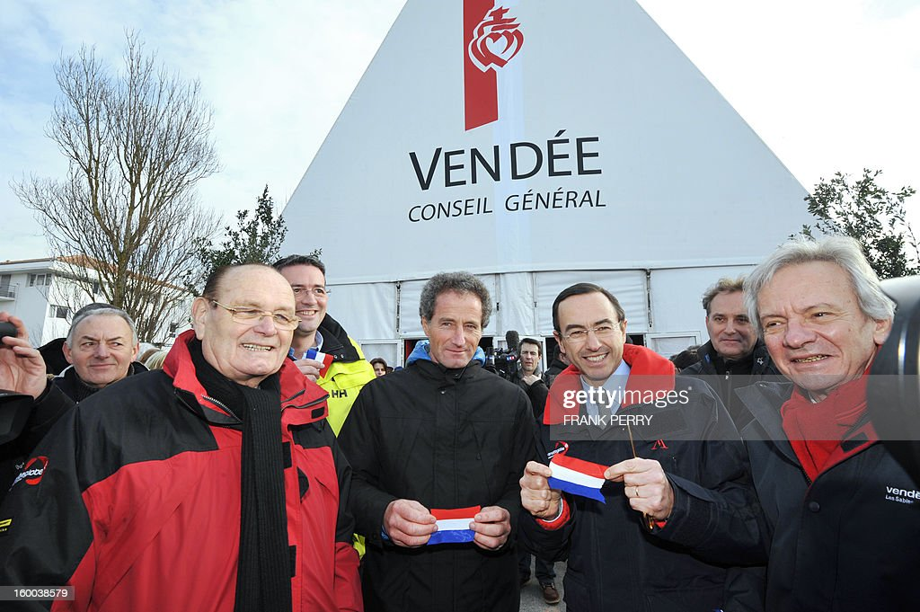 Head of the Vendee general council Bruno Retailleau (2ndR) French skipper Michel Desjoyeaux (C) and Sables d' Olonne mayor Louis Guedon (L) pose after inaugurating the Vendee Globe village on January 25, 2013 in Les Sables-d'Olonne. The Vendee Globe racers are approaching the French port of Les Sables d'Olonne, the finish line of the toughest, solo, round the world sailing race. The first finishers should be arriving in the next 24 hours. AFP PHOTO FRANK PERRY