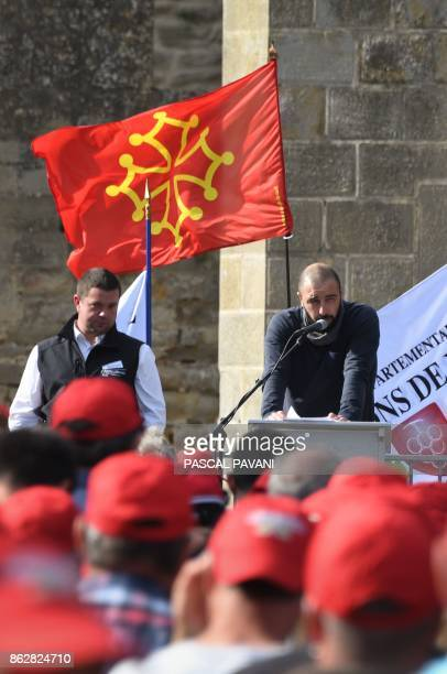 Head of the Winemakers Union of the Aude region Frederic Rouanet delivers a speech by the Occitan flag as winemakers demonstrate in the medieval city...
