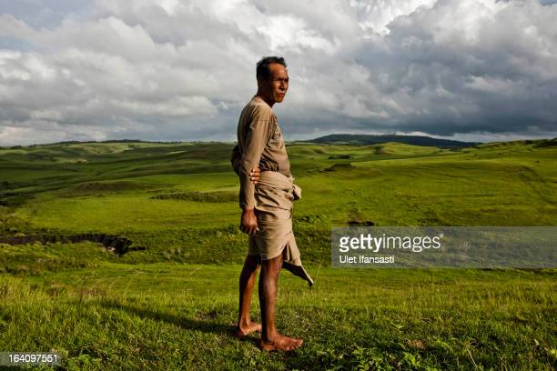 Head of tribe Luta Ndakuanau stands on the meadow in a Pambotajara village on March 1 2013 in Sumba Island East Nusa Tenggara Indonesia Sandalwood...