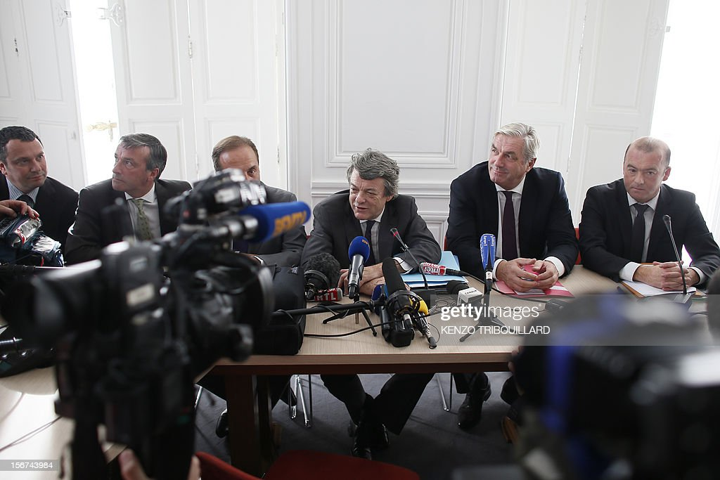 Head of Union of Democrats and Independents (UDI) party Jean-Louis Borloo (C) gives a press conference next to the vice-president of the party's group at the national assembly Francois Sauvadet (2ndR) on November 20, 2012 in Paris . AFP PHOTO / KENZO TRIBOUILLARD