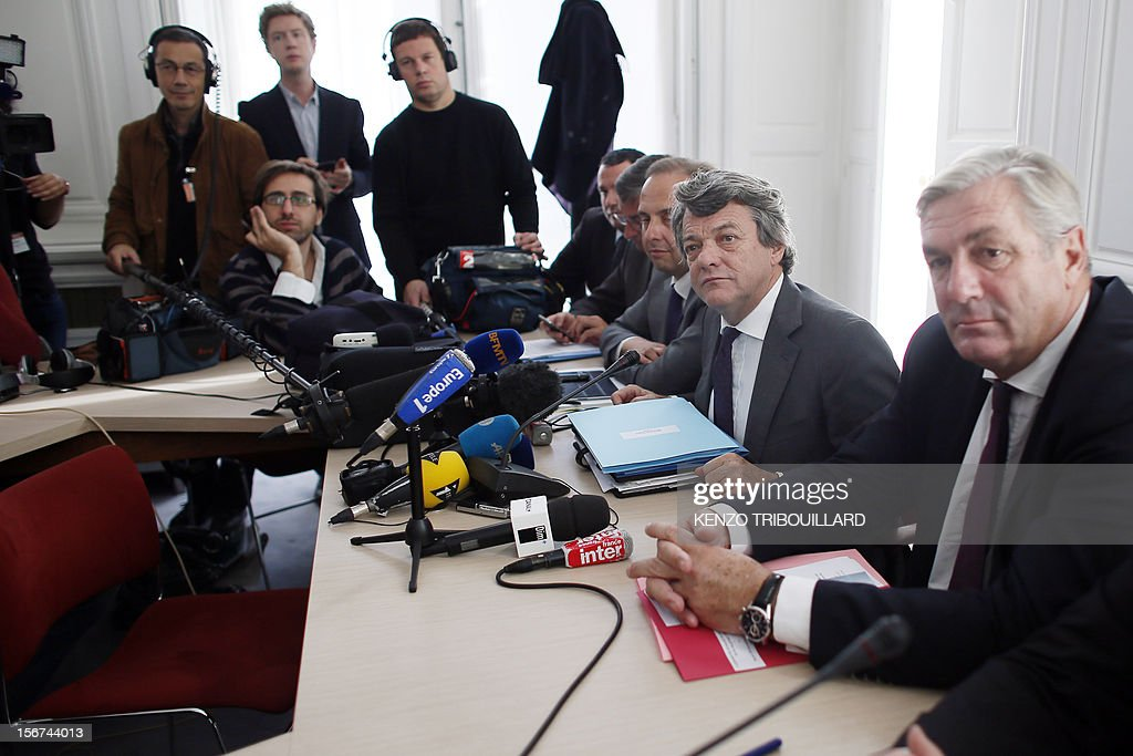 Head of Union of Democrats and Independents (UDI) party Jean-Louis Borloo (2ndR) gives a press conference next to the vice-president of the party's group (R) at the national assembly Francois Sauvadet (2ndR) on November 20, 2012 in Paris . AFP PHOTO / KENZO TRIBOUILLARD