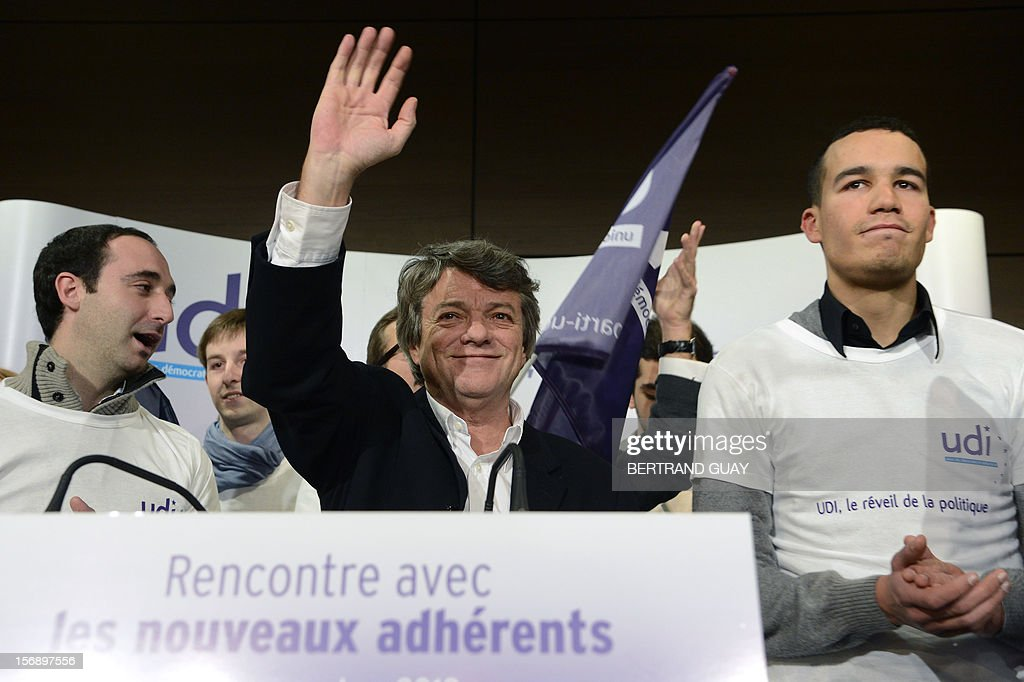Head of Union of Democrats and Independents (UDI) party, Jean-Louis Borloo (C) waves to the audience during a meeting with new UDI members on November 24, 2012 at the 'Maison de la Mutualite' conference centre in Paris. France's centre-right UDI and far-right Front National (FN) recently declared registering an increasing number of new memberships since the bitterly contested leadership election of main opposition right-wing party Union for a Popular Movement (UMP).