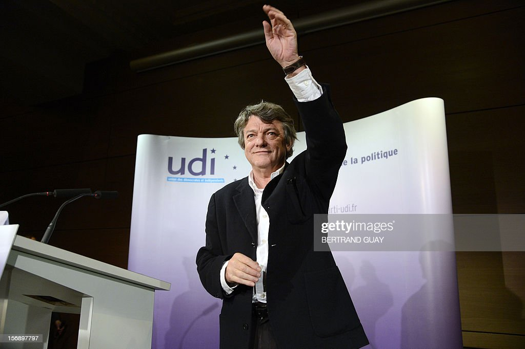 Head of Union of Democrats and Independents (UDI) party, Jean-Louis Borloo waves at the audience on November 24, 2012 at the 'Maison de la Mutualite' conference centre in Paris. France's centre-right UDI and far-right Front National (FN) recently declared registering an increasing number of new memberships since the bitterly contested leadership election of main opposition right-wing party Union for a Popular Movement (UMP). UMP appeared to have pulled back from the brink of disintegration, as both Jean-Francois Cope, the right-winger who was declared the winner of knife-edge vote last November 18, and his centrist rival Francois Fillon have agreed to mediation intended to establish who actually won and whether mutual allegations of ballot rigging had any foundation.