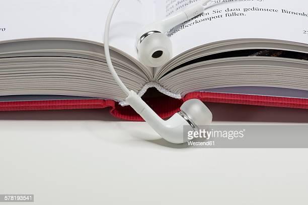Head phones lying on open book