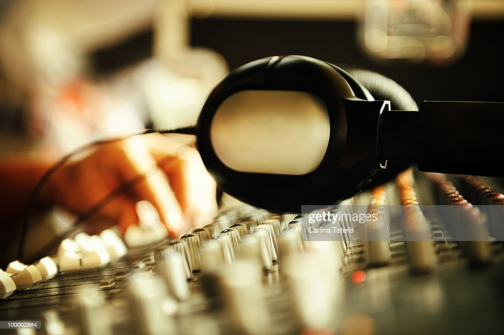 Head phones on sound board : Stock Photo