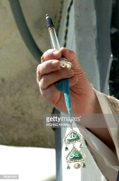 Head priest of the Hazratbal Shrine Gulam hassan Banday displays the holy relic believed to be a hair from the beard of the Prophet Mohammed from the...
