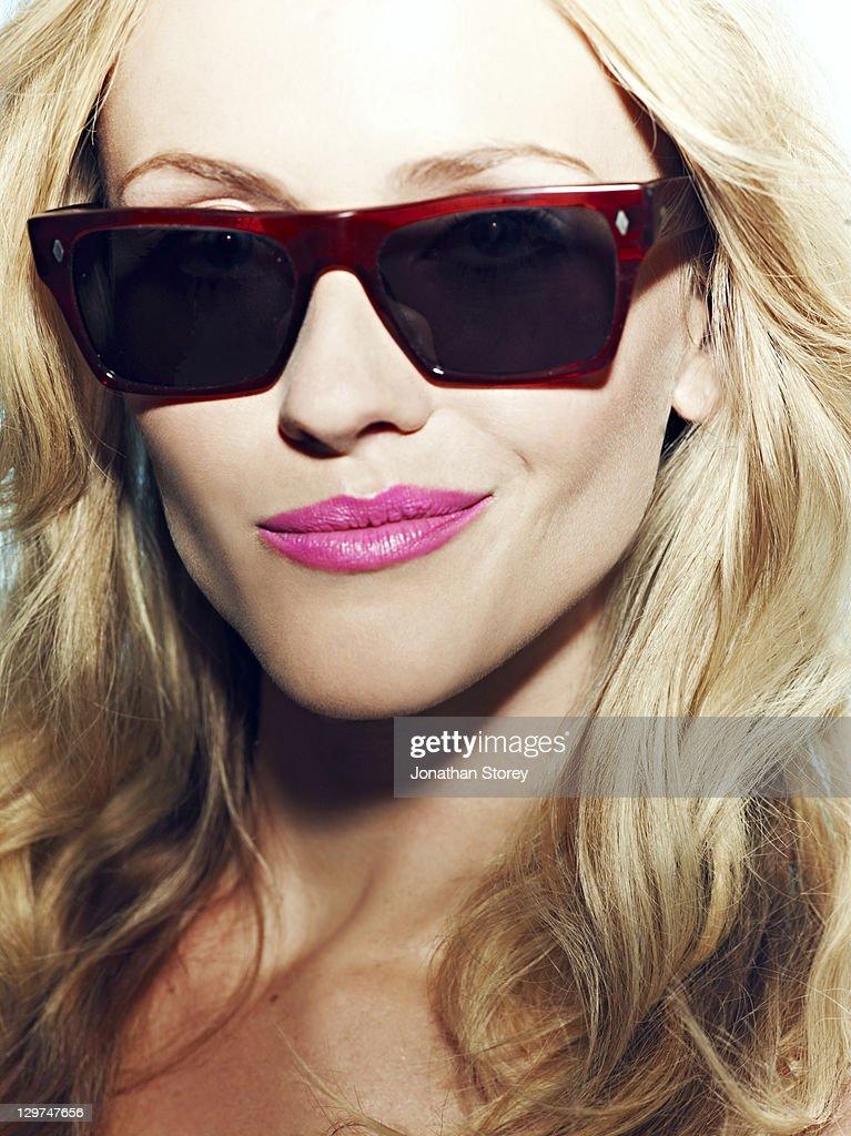 Head shot of female wearing sunglasses : Stock Photo