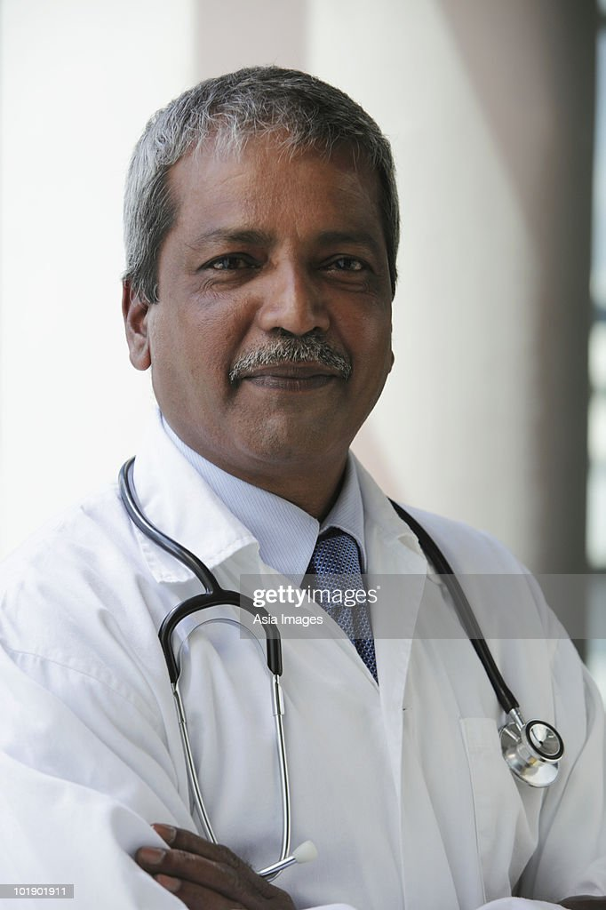 Head shot of Indian doctor : Stock Photo