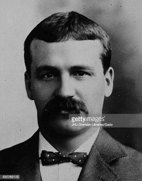Head shot of original faculty member of Johns Hopkins University Medicine John Miller Turpin Finney wearing a dark suit and a dark polkadotted bow...