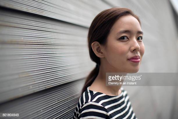 Head shot of woman in striped top.