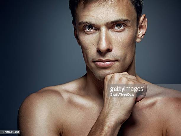 head shot of young shirtless man