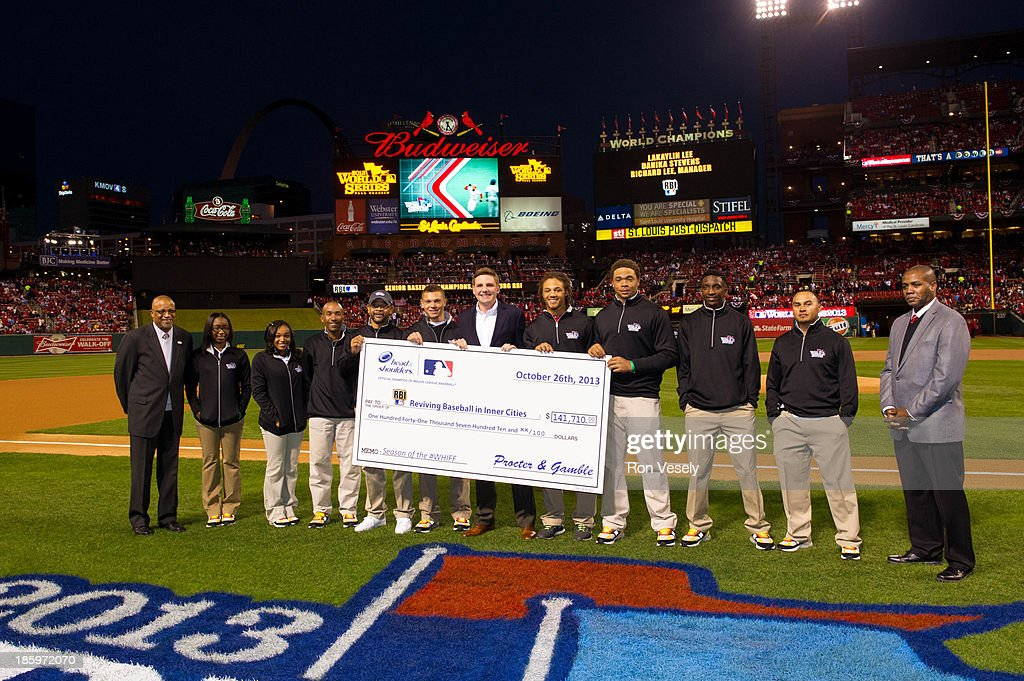 Head & Shoulders, the Official Shampoo of Major League Baseball presents the RBI program with a check resulting figure from their 2013 MLB Season of the #Whiff Twitter program during the pre-game ceremonies before Game 3 of the 2013 World Series between the St. Louis Cardinals and the Boston Red Sox at Busch Stadium on Saturday, October 26, 2013 in St. Louis, Missouri.