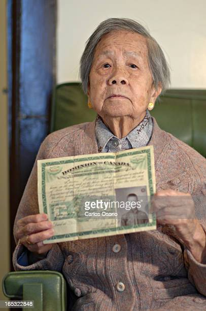 Head Tax Foon Hay Lum holds a Chinese Head Tax certificate which belonged to her husband Jack Nam Lum For Special Section on Chinese New Year