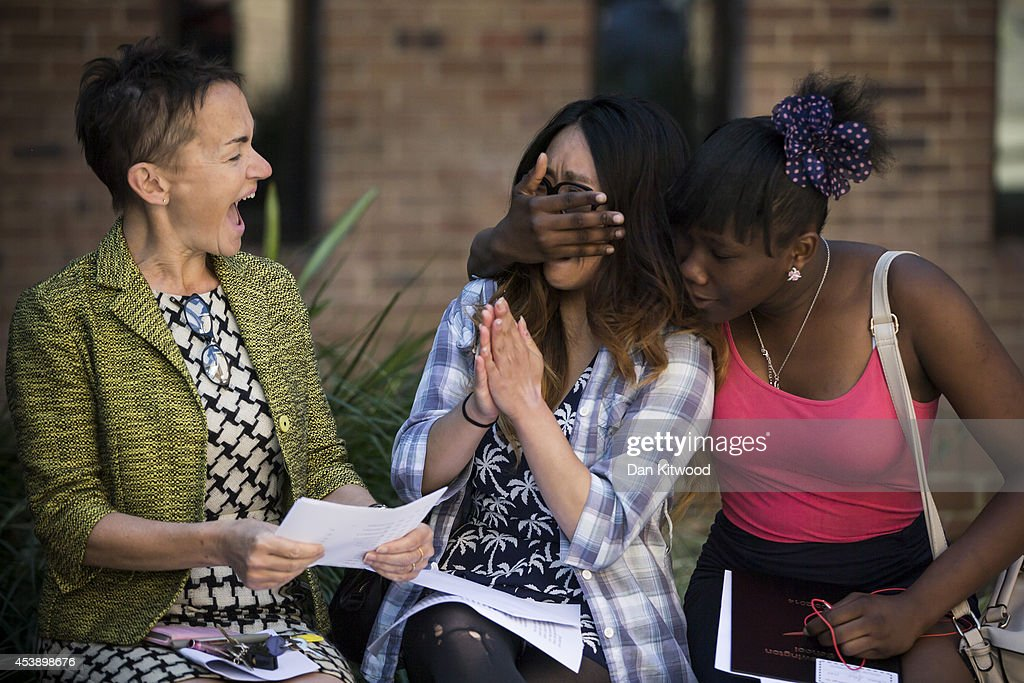 Head teacher Annie Gammon and pupils at Stoke Newington school react while opening GCSE results on August 21, 2014 in London, England. As hundreds of thousands of students opened their GCSE results today it has emerged that the proportion of GCSEs awarded A - C grade has risen to the highest in three years.